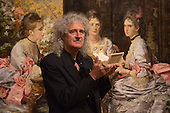 "London, United Kingdom. 20 October 2014. Photocall with astrophysicist and Queen's guitarist Dr Brian May at Tate Britain for the exhibition ""Poor Man's Picture Gallery: Victorian Art and Stereoscopic Photography"", running until 12 April 2015. Brian May stands in front of the painting Hearts are Trumps, 1872, by Sir John Everett Millais that was inspired by Michael Burr's stereograph six years earlier. stereograph Brian May has lent a rare collection of Victorian stereographic photographs to Tate Britain that are featured in the exhibition. This is the first display in a major British art gallery devoted to the 19th century craze of three-dimensional photography, known as stereographs. Some photographs are mounted side by side with oil paintings that inspired painters. Photo: Bettina Strenske"