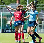 NIJMEGEN -   Mascha Heemskerk (Huizen) brengt de stand op 0-3 tijdens de tweede play-off wedstrijd dames, Nijmegen-Huizen, voor promotie naar de hoofdklasse..rechts Lara Kok (Huizen) .  COPYRIGHT KOEN SUYK