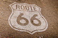 Route 66 shield painted on the road near the world famous Snow Cap Drive in, located in Seligman Arizona on Historic Route 66.  Juan Delgadillo opened the drive in in 1953 after building it with scrap lumber.