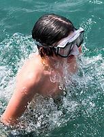 Diving for treasure at the Corunna Stage Island ferry dock is a great pastime for teenagers on summer holidays.Dallas Mesko, 15, of Corunna.