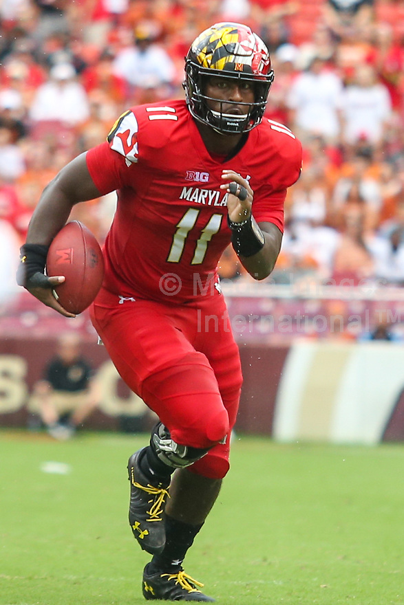 Landover, MD - September 1, 2018: Maryland Terrapins quarterback Kasim Hill (11) runs the ball during the game between Texas and Maryland at  FedEx Field in Landover, MD.  (Photo by Elliott Brown/Media Images International)