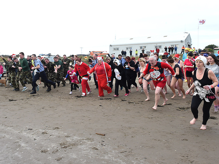 The run to the water at the Polar Plunge at Clogherhead Beach. Photo:Colin Bell/pressphotos.ie