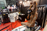 A model dressed at a leopard poses on a motorcycle in the Norton clothing stand at the 44th annual Tokyo Motorcycle show. Tokyo Big Sight exhibition hall, Odaiba, Tokyo, Japan. Friday March 24th 2017. The show runs from Friday March 24th to Sunday March 26th and showcases technological innovations from all the main motorcycle manufacturers along with companies providing protective helmets pads and  clothing to decoration and even camping gear for bike-touring..