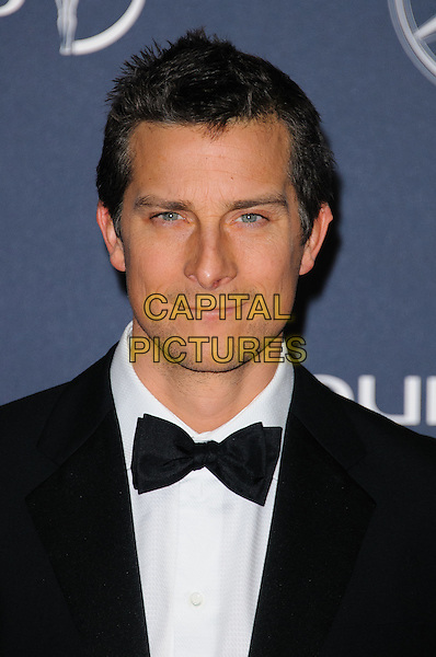Bear Grylls.Arrivals at the Laureus 2012 World Sports Awards held at the Queen Elizabeth II Centre, London, England..February 6th, 2012.headshot portrait black white tuxedo bow tie   .CAP/CJ.©Chris Joseph/Capital Pictures.