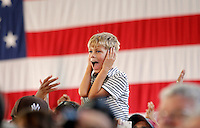 A young boy covers his ears as supporters cheer for President Barack Obama during a campaign stop at the nTelos Wireless Pavilion in Charlottesville, VA.