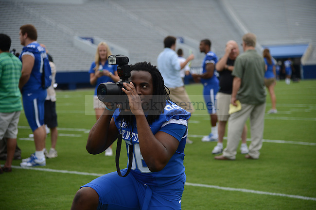 Senior Collins Ukwu plays around with a photographers camera at UK Football Media Day on Friday, August 3, 2012. Photo by Mike Weaver| Staff