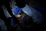 The body of a young girl, who died after a regime mortar shell landed next to a bread shop in north Aleppo, waits to be identified by her family in a makeshift  hospital at an undisclosed location of the city.  ..© Javier Manzano.