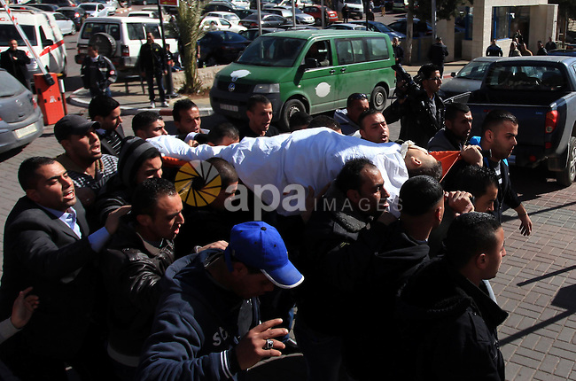 Palestinian relatives of Muhammad Mubarak, 21, carry his body during a funeral in the West Bank city of Ramallah January 29, 2014. Israeli soldiers killed Mubarak on Wednesday who the military said had opened fire on their position near a Jewish settlement in the occupied West Bank. Photo by Issam Rimawi