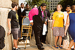 July 13, 2015. Winston Salem, North Carolina.<br />  Reverend William Barber, the president of the NC NAACP, leaves the federal courthouse on the opening day of the NC NAACP's court case against Gov. Pat McCrory.<br />  To rally support for the North Carolina NAACP's case against Gov. Pat McCrory (NC NAACP v. McCrory), a march was held in downtown Winston Salem on the opening day of the case in federal court. Thousands gathered to walk the streets of downtown and listen to speeches proclaiming the importance of defeating new requirements for voter registration,<br />  The NC NAACP contests that HB 589 (Voter ID requirements) violate Section 2 of the Voting Rights Act (42 U.S.C. 1973) and the Fourteenth and Fifteenth Amendments of the Constitution.