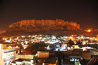 "The stunning iconic Jodhpur fort by night overlooking Rajasthan's ""Blue City"", Rajasthan, India."