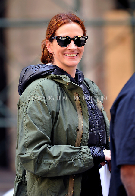 WWW.ACEPIXS.COM<br /> <br /> April 18 2015, New York City<br /> <br /> Actress Julia Roberts was on the downtown set of the new movie 'Money Monster' on April 18 2015 in New York City<br /> <br /> By Line: Curtis Means/ACE Pictures<br /> <br /> <br /> ACE Pictures, Inc.<br /> tel: 646 769 0430<br /> Email: info@acepixs.com<br /> www.acepixs.com