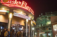 People enter the Cask 'n Flagon bar outside Fenway Park in the Fenway neighborhood of Boston, Massachusetts, USA, in the early hours of Saturday, Dec. 5, 2015.