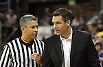 Tony Bennett, Head Coach at Washington State University, confers with one of the officials during the Cougars Pac-10 conference showdown with the University of Washington on March 7, 2009, in Seattle, Washington.  Both teams came in to the game on a roll, and in a hard fought battle, the Huskies prevailed 67-60 to wrap up the regular season Pac-10 championship.