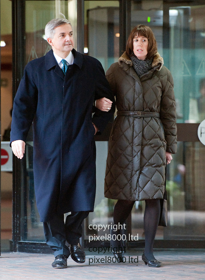 Chris Huhne and Carina Trimmingham  leave at Southwark Crown Court today 4.2.13..He pleaded guilty and resigned today..He walks out to tell the press he is resigning...She and her former husband MP Chris Huhne are charged with perverting the course of justice....Vasiliki Pryce, née Courmouzis, is an economist, and former Joint Head of the United Kingdom's Government Economic Service......Pic by Gavin Rodgers/Pixel 8000 Ltd
