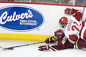 Brett Motherwell 8 of Boston College manages to reach the puck despite Andy Brandt 21 of the University of Wisconsin. The Boston College Eagles defeated the University of Wisconsin Badgers 3-0 on Friday, October 27, 2006, at the Kohl Center in Madison, Wisconsin in their first meeting since the 2006 Frozen Four Final which Wisconsin won 2-1 to take the national championship.<br />