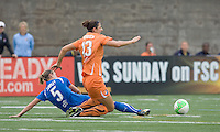 Boston Breakers midfielder Lindsay Tarpley (5) tackles Sky Blue FC midfielder Yael Averbuch (13). Sky Blue FC defeated the Boston Breakers, 2-1, at Harvard Stadium on June 13, 2010.