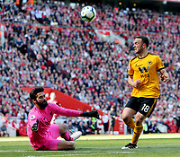 Liverpool's Alisson Becker charges down an effort by Wolverhampton Wanderers' Diogo Jota<br /> <br /> Photographer Rich Linley/CameraSport<br /> <br /> The Premier League - Liverpool v Wolverhampton Wanderers - Sunday 12th May 2019 - Anfield - Liverpool<br /> <br /> World Copyright © 2019 CameraSport. All rights reserved. 43 Linden Ave. Countesthorpe. Leicester. England. LE8 5PG - Tel: +44 (0) 116 277 4147 - admin@camerasport.com - www.camerasport.com