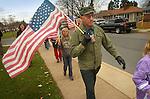 Local veterans and their families march around Lyter Elementary School during a Veterans Day ceremony.
