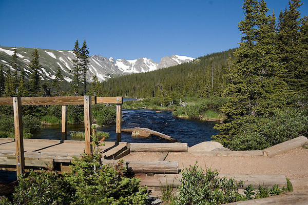 Wooden hiking bridge over Saint Vrain Creek and Long Lake, Indian Peaks Wilderness Area west of Boulder, Colorado. Private guided tours to Indian Peaks. Private photo tours to Indian Peaks. .  John leads private photo tours throughout Colorado. Year-round Colorado photo tours.