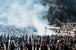 The crowd watches as Buddhist monks light a ceremonial bonfire during the Fire-walking Festival (Hiwatari-sai) at Mt. Takao on Sunday, March 12, 2017 in Hachioji, Japan.<br /> Photo by Kevin Clifford