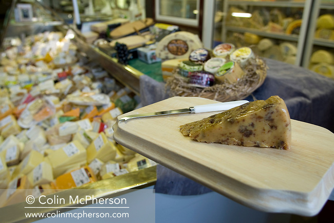 A selection of cheeses on display at  Godfrey C Williams & son in Sandbach, Cheshire and pictured as part of the newly-established Cheshire Food Trail. The business specialises in cheeses, such as the sticky toffee cheese pictured, as well as other delicatessen specialities.