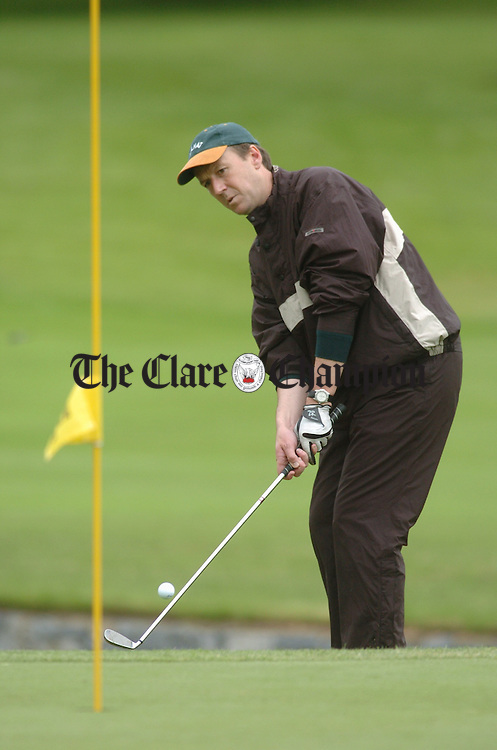 John Wall of Lahinch chips onto the green during the Pierce Purcell competition at Dromoland. Photograph by John Kelly.