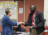 NWA Democrat-Gazette/CHARLIE KAIJO Rogers Public Education Foundation Board Member and Secretary (left) presents a grant award to teacher Akau Anyieth (right), Monday, May 13, 2019 at Heritage High School in Rogers.<br /><br />Members of the Rogers Public Education Foundation awarded over $172,000 in grants to teachers during surprise visits Monday. <br /><br />These grants will help fund many classroom needs that are beyond the schoolsÕ budgets including additional iPads, Chromebooks, video equipment, math tools, integrated movement opportunities, as well as supplies for literacy activities, science, art, physical education and music.