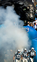 The Carolina Panthers run onto the field prior to playing the Arizona Cardinals during an NFL football game at Bank of America Stadium in Charlotte, NC.