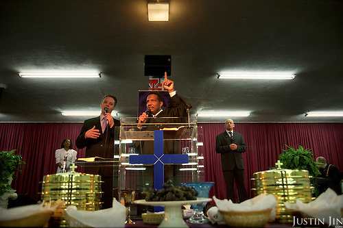 Pastor Jofrey speaks to his Sunday congregation in Amsterdam...Victory Outreach, a controversial church started in Los Angeles in 1967, is spreading to Europe via the Netherlands. It builds its membership among junkies, prostitutes and criminals. ..Photo taken in the Netherlands in 2002. The picture is part of a photo and text documentary by Justin Jin. For more information, email justin@justinjin.com