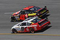 May 6, 2007; Richmond, VA, USA; Nascar Nextel Cup Series driver Juan Pablo Montoya (42) races alongside Kasey Kahne (9) during the Jim Stewart 400 at Richmond International Raceway. Mandatory Credit: Mark J. Rebilas
