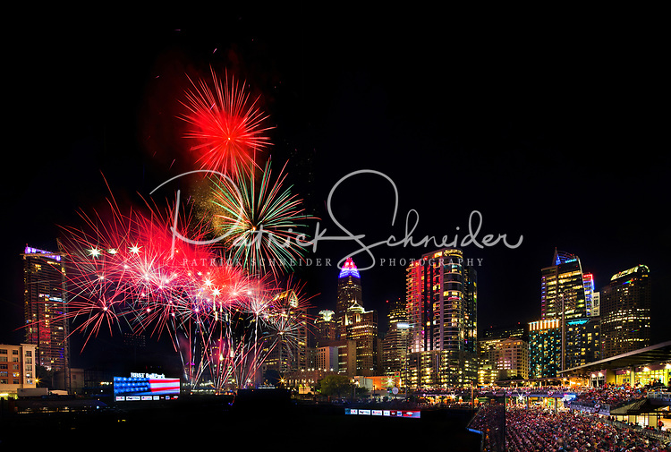 Fireworks from Skyshow Charlotte  2019explode over BB&T Ballpark against the backdrop of the Charlotte NC skyline as the city celebrated the July 4th holiday in 2018Photographer has fireworks celebrations in Charlotte from multiple years. The collection of Charlotte NC fireworks photos show different perspectives and weather conditions.<br /> <br /> Charlotte Photographer - PatrickSchneiderPhoto.com