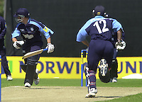 .14/07/2002 - Sport - Cricket- Norwich Union League..Middlesex Crusaders vs Gloucester Gladiators.Craig Spearman, right and Tim Hancock staedy the Gloucester inning after the loss of two early wickets.