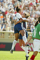 Shannon Boxx, left, and Brandi Chastain, right, celebrate a goal, USWNT vs. Mexico, September 7, 2003.