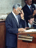 Washington, D.C. - June 26, 1990 -- Nelson Mandela, leader of the African National Congress (ANC) adjusts his glasses as he addresses a Joint Session of the United States Congress  in Washington, DC on Tuesday, June 26, 1990.  .Credit: Ron Sachs / CNP