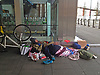Rough Sleeper camped at Reading Station with his bicycle and belongings. Stock Photo by Paddy Bergin