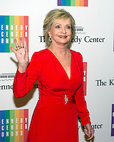 Florence Henderson arrives for the formal Artist's Dinner honoring the recipients of the 2013 Kennedy Center Honors hosted by United States Secretary of State John F. Kerry at the U.S. Department of State in Washington, D.C. on Saturday, December 7, 2013. The 2013 honorees are: opera singer Martina Arroyo; pianist,  keyboardist, bandleader and composer Herbie Hancock; pianist, singer and songwriter Billy Joel; actress Shirley MacLaine; and musician and songwriter Carlos Santana.<br /> Credit: Ron Sachs / CNP /MedaPunch