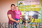 Kerry footballer, Aidan O'Mahony, with Kayla Dineen and the Sam Maguire.