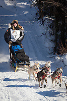Musher Kristy Berington on Long Lake at the Re-Start of the 2011 Iditarod Sled Dog Race in Willow, Alaska.