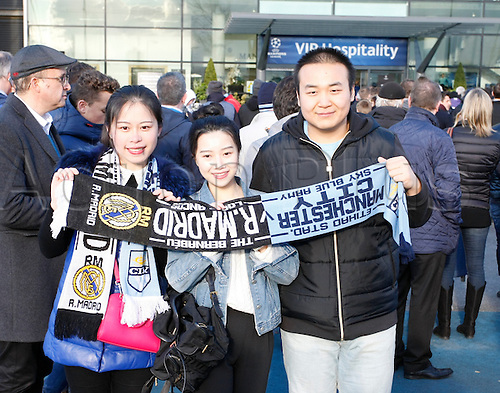 26.04.2016. The Etihad, Manchester, England. UEFA Champions League. Manchester City versus Real Madrid. Manchester City fans from China outside the Etihad Stadium before tonight's game.