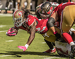 San Francisco 49ers running back DuJuan Harris runs for extra yards on Sunday, October 23, 2016, at Levis Stadium in Santa Clara, California. The Buccaneers defeated the 49ers 34-17.