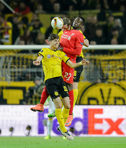 07.04.2016. Dortmund, Germany. Europa League quarterfinal. Borussia Dortmund versus Liverpool FC at the Signal Iduna Park Dortmund.   Dortmunds Julian Weigl and Sven Bender challenge Liverpools Divock Origi.