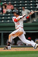 Second baseman Mauricio Dubon (10) of the Greenville Drive bats in a game against the Asheville Tourists on Friday, April 24, 2015, at Fluor Field at the West End in Greenville, South Carolina. Dubon is the No. 23 prospect of the Boston Red Sox, according to Baseball America. Greenville won, 5-2. (Tom Priddy/Four Seam Images)