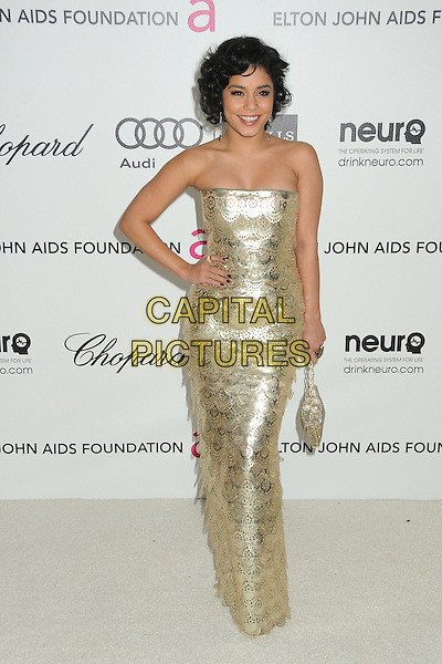 Vanessa Hudgens.20th Annual Elton John Academy Awards Viewing Party held at West Hollywood Park, West Hollywood, California, USA..February 26th, 2012.oscars full length dress gold strapless sequins sequined hand on hip  handbag purse .CAP/ADM/BP.©Byron Purvis/AdMedia/Capital Pictures.