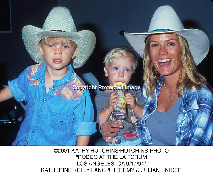 "©2001 KATHY HUTCHINS/HUTCHINS PHOTO.""RODEO AT THE LA FORUM.LOS ANGELES, CA 9/17/94"". KATHERINE KELLY LANG & JEREMY & JULIAN SNIDER"