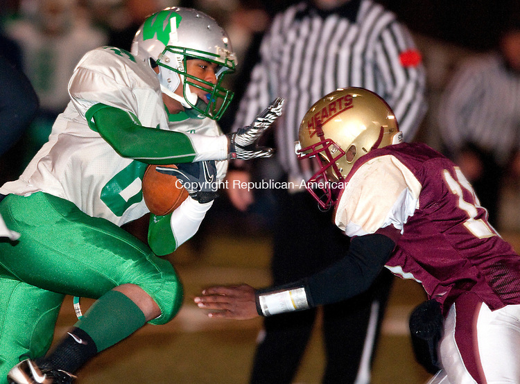 WATERBURY, CT, 24 NOVEMBER 2010-112410JS09-- Wilby's Robert Williams (6) gets by Sacred Heart Rohan Ifill (10) to score a fourth quarter touchdown in thir 62-30 win Wednesday at Municipal Stadium in Waterbury. <br />  Jim Shannon Republican-American