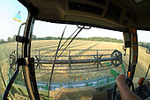 Wide angle view from operating cab of combine harvester