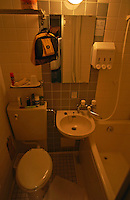 Too small hotel room and bath (note single faucet for both sink and tub) Utsunomiya, Tochigi Prefecture, Japan  April 2003                           .©F. Peirce Williams 2003..F. Peirce Williams .photography.P.O.Box 455 Eaton, OH 45320.p: 317.358.7326  e: fpwp@mac.com