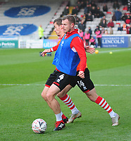 Lincoln City's Michael O'Connor and Harry Toffolo during the pre-match warm-up<br /> <br /> Photographer Andrew Vaughan/CameraSport<br /> <br /> Emirates FA Cup First Round - Lincoln City v Northampton Town - Saturday 10th November 2018 - Sincil Bank - Lincoln<br />  <br /> World Copyright © 2018 CameraSport. All rights reserved. 43 Linden Ave. Countesthorpe. Leicester. England. LE8 5PG - Tel: +44 (0) 116 277 4147 - admin@camerasport.com - www.camerasport.com