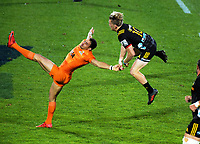 Damian McKenzie and Joaquin Tuculet compete for high ball during the Super Rugby match between the Chiefs and Jaguares at Rotorua International Stadum in Rotorua, New Zealand on Friday, 4 May 2018. Photo: Dave Lintott / lintottphoto.co.nz