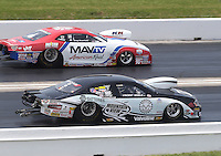 Apr. 28, 2013; Baytown, TX, USA: NHRA pro stock driver Vincent Nobile (near lane) races alongside Greg Stanfield during the Spring Nationals at Royal Purple Raceway. Mandatory Credit: Mark J. Rebilas-